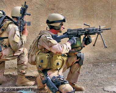Navy Petty Officer 2nd Class (Sea, Air, and Land) Michael Monsoor in combat in Ramadi, 2006.
